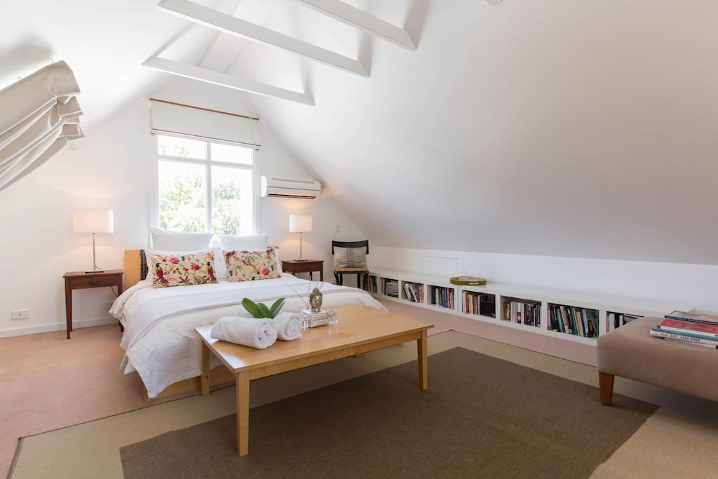 Large private loft space on third level of quiet home.