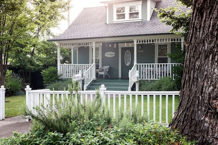 Sleeps eight  - 4 bedroom (2 queen beds, four twin beds), 3 full bath home with fabulous front porch, full kitchen, laundry and all amenities.  Two blocks to theaters, shopping, restaurants, nightlife. Can be rented with Garden Suite (sleeps 5).