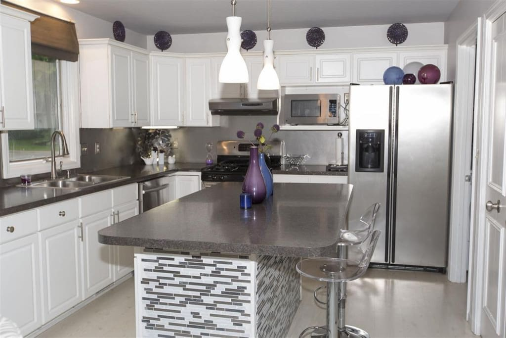 Completely stocked, modern kitchen with breakfast bar. All essentials for cooking and eating in