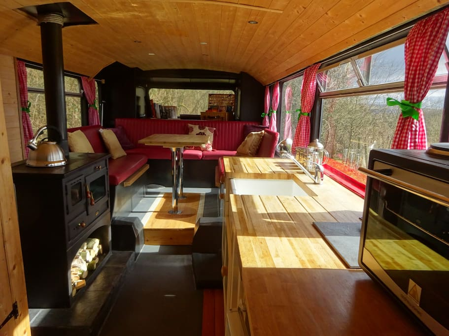 The wood stove warms the dining area which can also be used as an extra double bedroom.