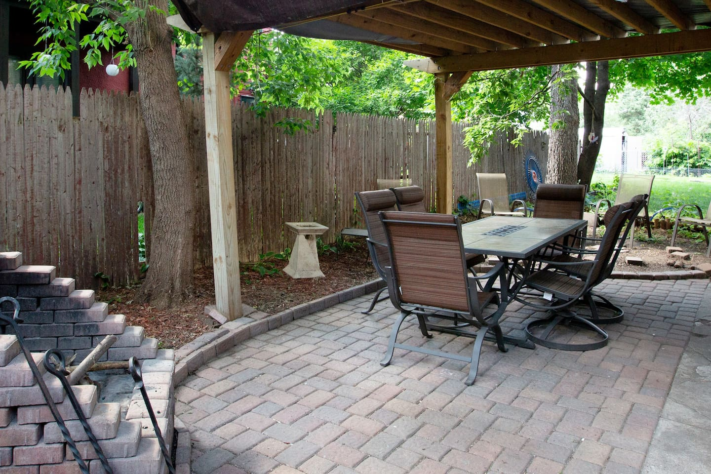 Fenced private patio with fireplace, pergola, and grill; in the heart of Uptown!