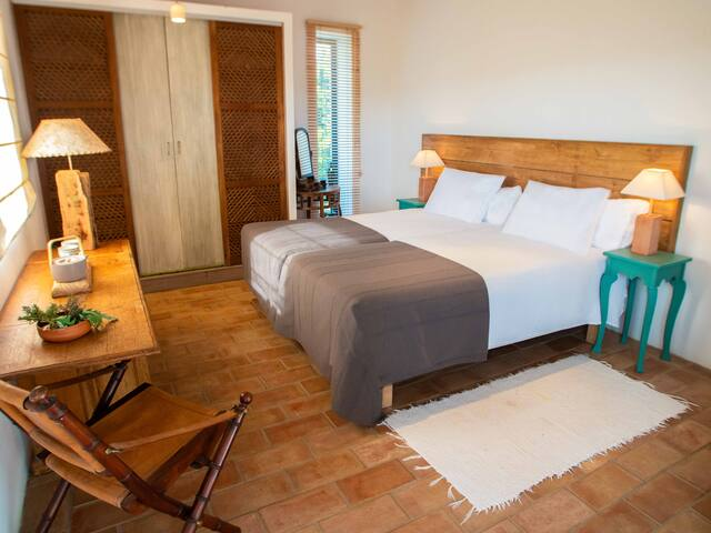 Room Poente is located on the 1st floor in Casa Terra. From the room you have direct access to a terrace  from where you can enjoy the beautiful sea view and the gardens at leisure.