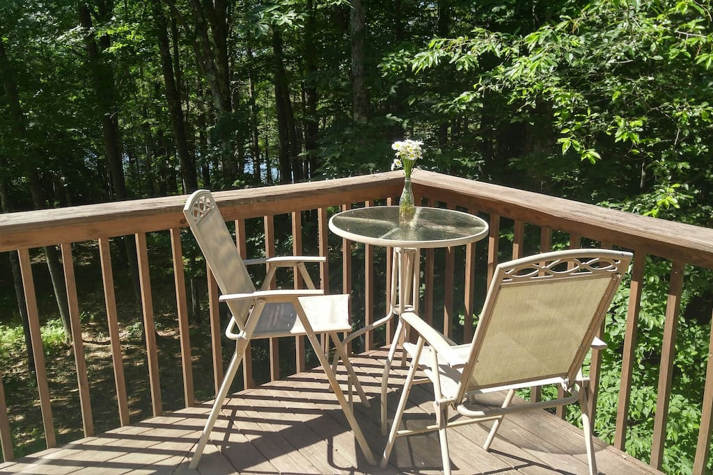 Outside deck with tree-level view.