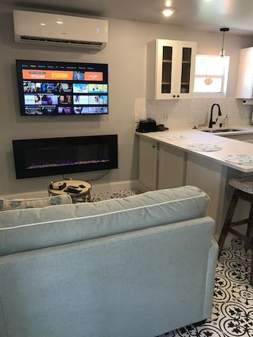 """Living area with 50"""" tv and electric fireplace"""