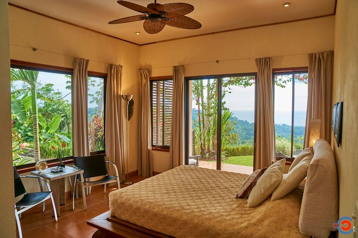 Guest room with beautiful Balinese bed just steps from the pool.
