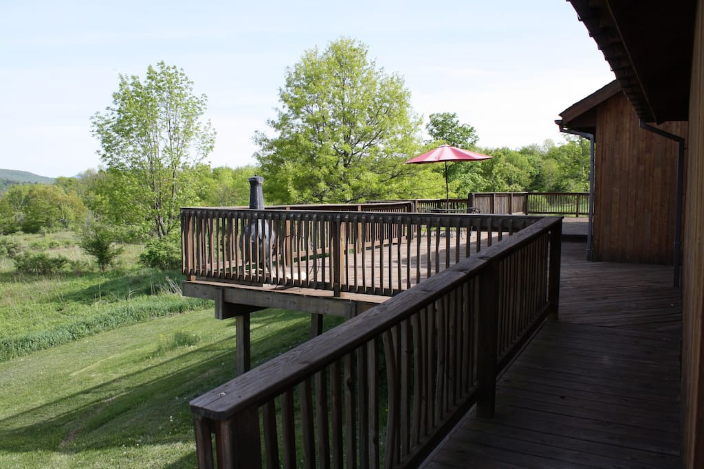 Deck wraps around three sides of the house