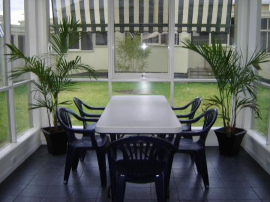 Part of the shared common room. A nice eating nook overlooking the courtyard.