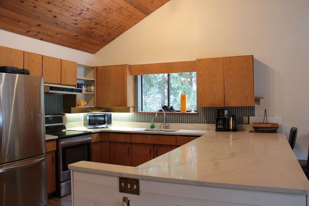 FULLY EQUIPPED KITCHEN W/ LARGE ISLAND TO ENTERTAIN GUEST