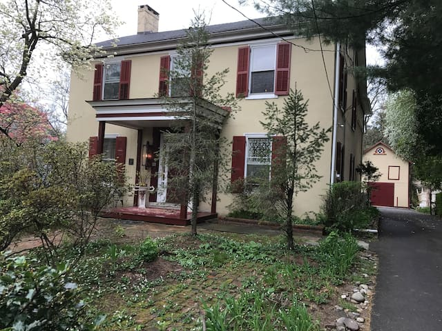 The front of the home is a restored Bucks County Classic Stone Manor House c 1833.