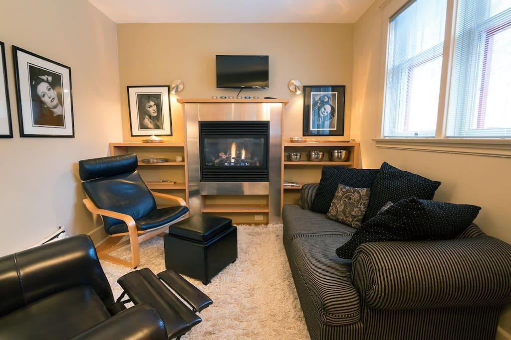 Sitting room with gas fireplace and TV, recliner chair