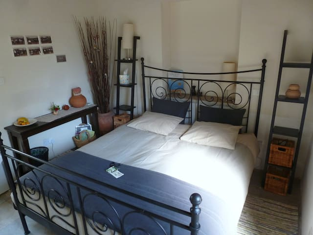 The room with a double bed  (memory-foam mattress topper)