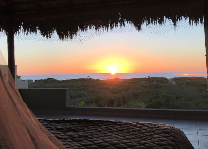 Sunsets from your King bed. Steps to the beach