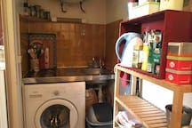kitchen with fridge, plates, oven and boiler
