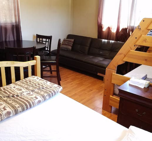 2 Double Beds in this room plus Leather Futon Sofa.
