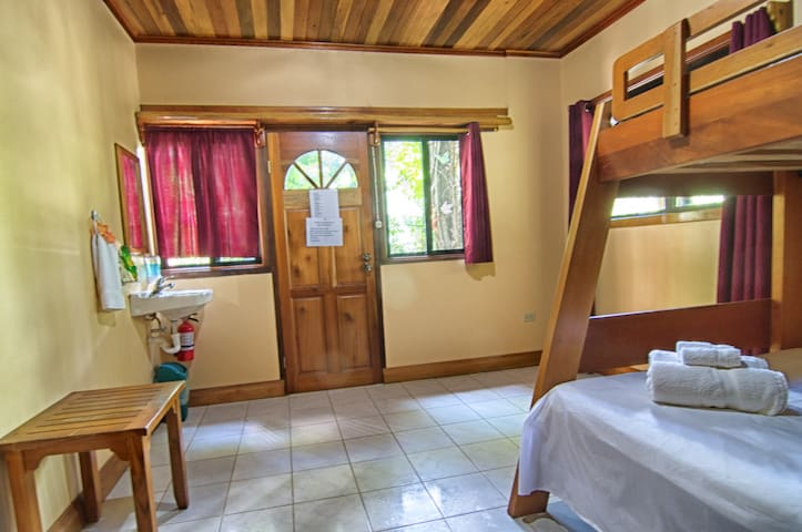 Cozy and clean Bedroom at Better in Belize vacation rental house.