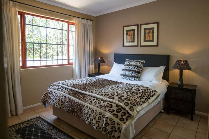 Comfortable sunny bedroom and queen size bed