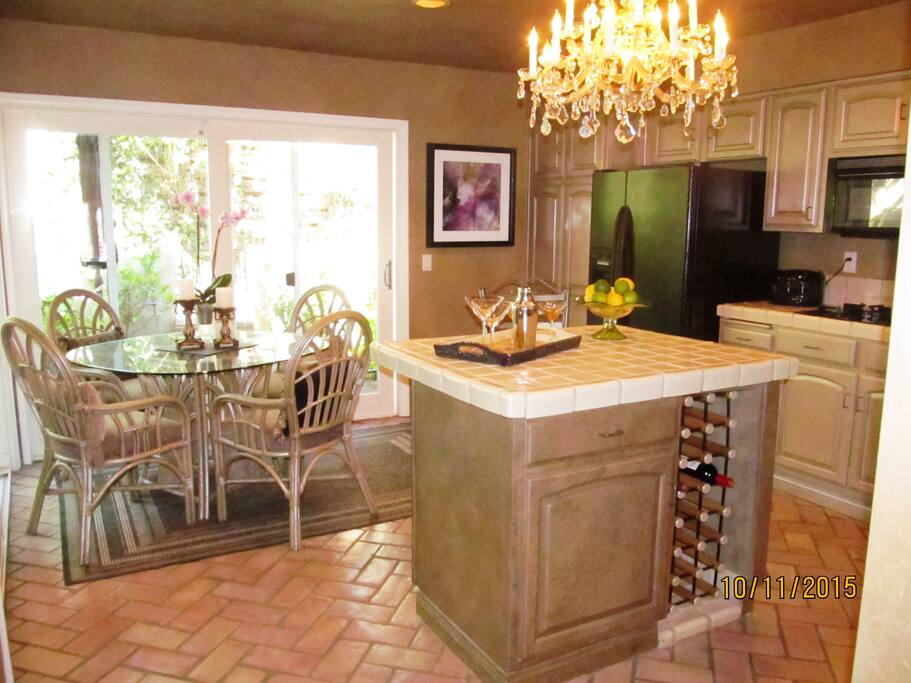 With wine storage in the island and breakfast nook by the patio.