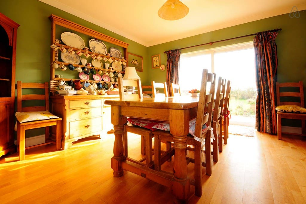 Dining Room with dresser and views onto the gardens