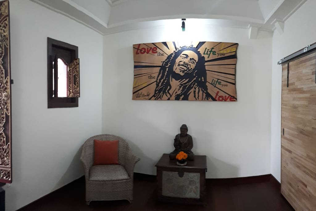 Love the life you live  Live the life you love  Bob Marley panel inside room, and also we put litle Budha statue to give positif energi for this room