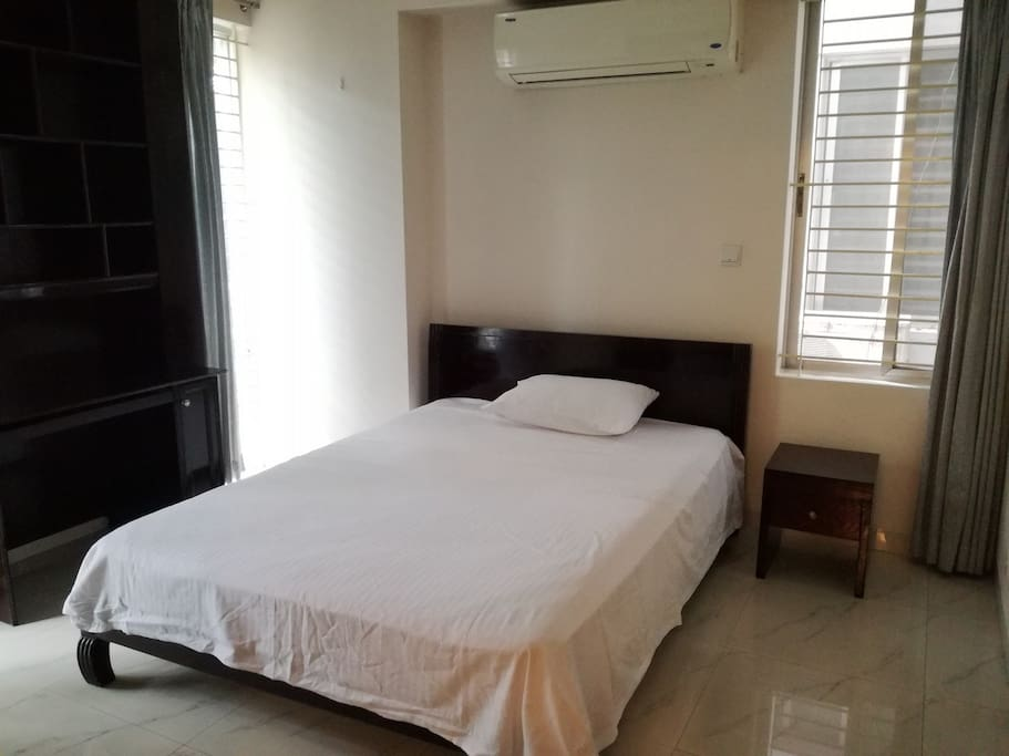 This the third room of our apartment. There is also one attached bathroom, one king size bed with one side drawer, one reading table. Air Condition is also available.