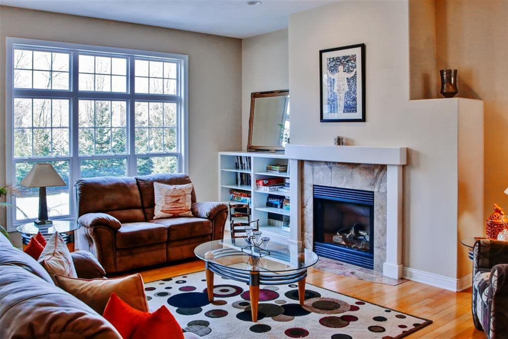 Unwind in this bright living room next to the welcoming fireplace.