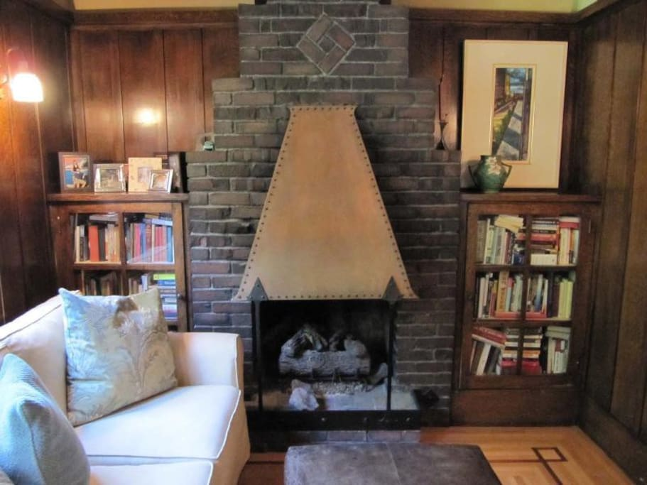 "Cozy den with 50"" flatscreen and gas fireplace w/antique copper hood"
