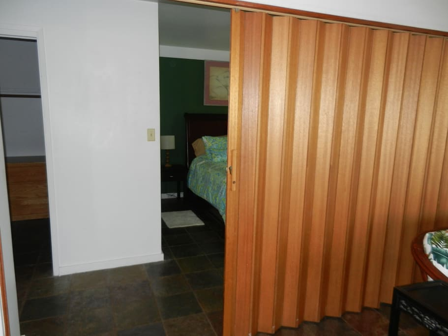 The folding wall between the bedroom and living room