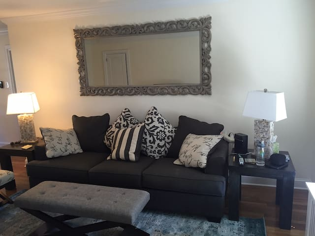 Living room, with new sofabed, and end tables