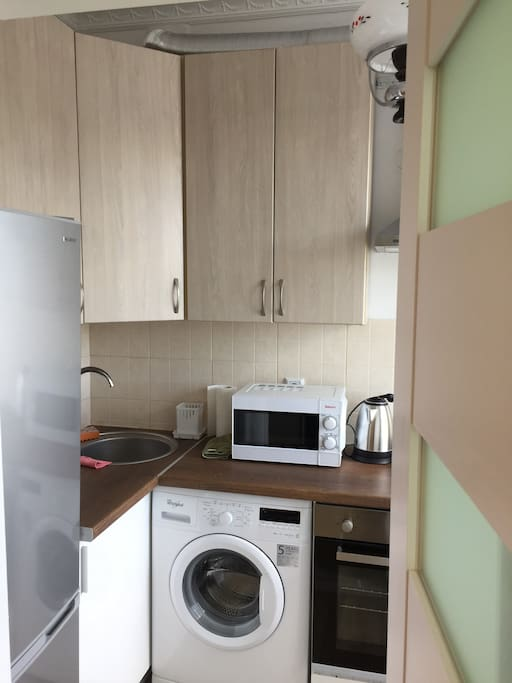 Kitchen with brand new and modern white goods