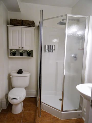 Private en-suite 3 PC bathroom with rain shower. We provide you with shampoo, conditioner and body wash.