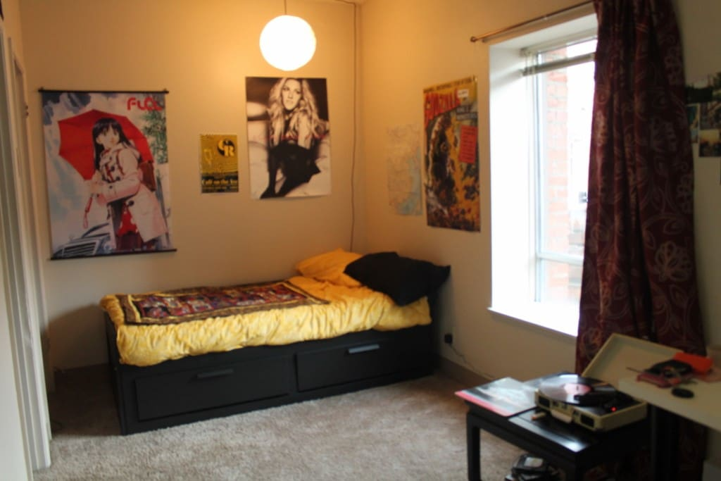 Left/West Side: Bed area and Record Player.