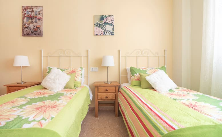 This bright room contains two full size single beds, suitable for both adults and children.