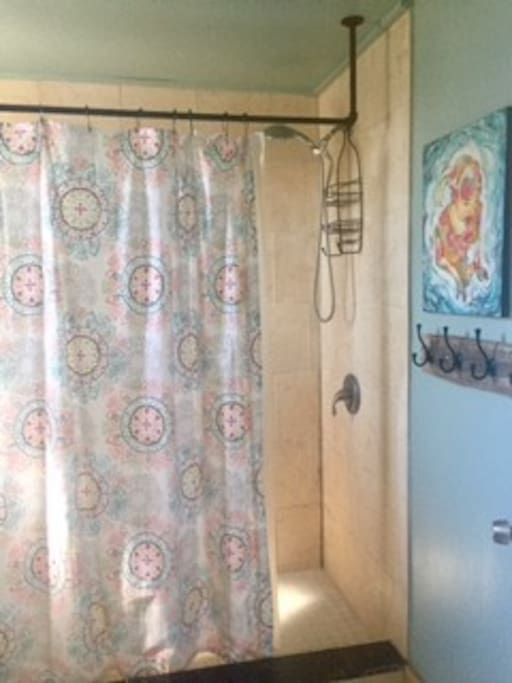 The one bathroom is in the back of the house is sunny and features this spacious shower.
