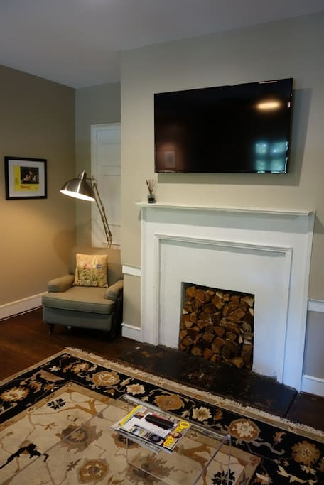 TV over mantle with reading chair