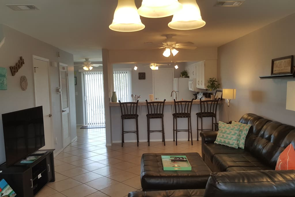 Remodel Kitchen with open bar. Roku Ready TV, Bar seating and doorway leading to the Balcony