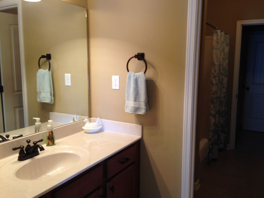 The upstairs bathroom is Jack-and-Jill style. You will have the sink and counter area to yourself, and the shower and toilet in the middle is shared with another guest room.