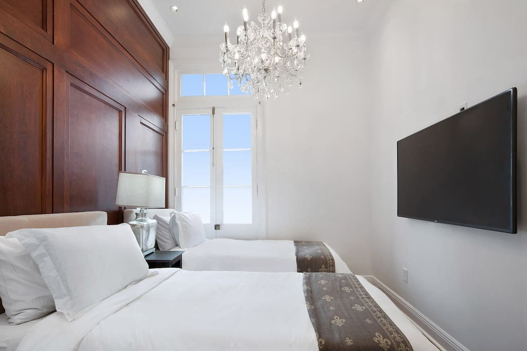 Two twin beds perfect for movie watching in between trips to the French Quarter