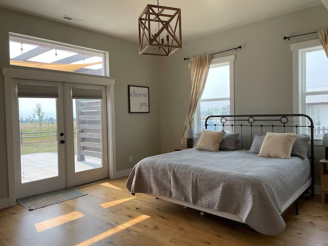 """Main master bedroom. This is the """"Valley"""" room. Patio access and lots of natural light."""