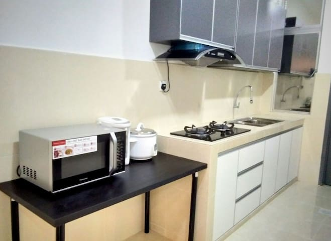 kitchen occupied with water heater,rice cooker,microwave