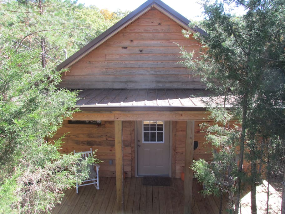 Front of the cabin. It is secluded in the pine woods for all the privacy you want.
