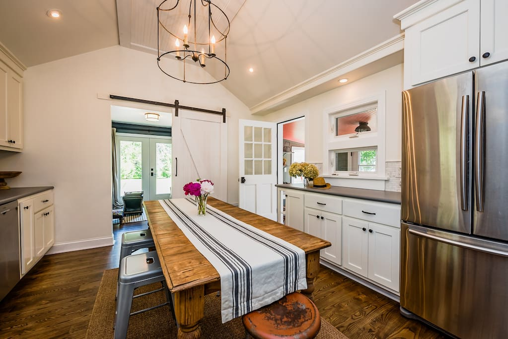 The spacious & immaculate kitchen. Like the rest of the house, it's a mix of vintage finds and top-of-the-line modern amenities.
