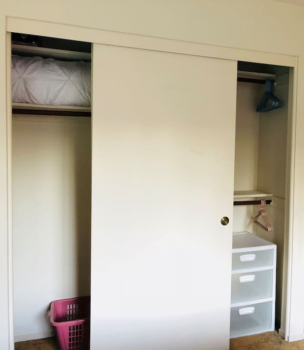 Ample closet for storage with hangers, pillow and extra blanket