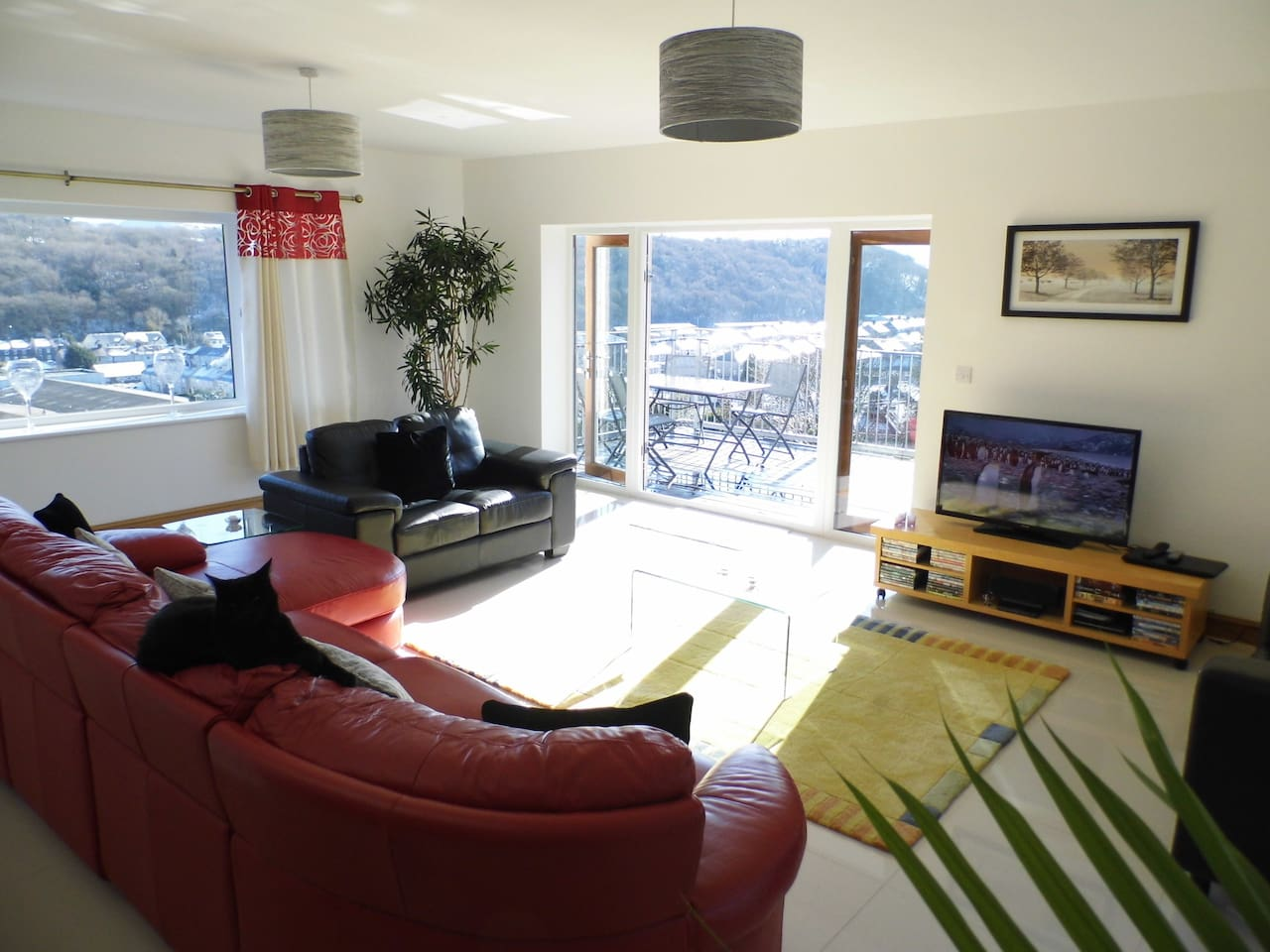 Lounge with large screen TV with Freeview and a DVD Player, plenty of DVDs also available for guests.