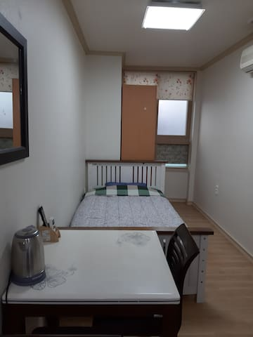 It's 3 minutes walk from the main gate of Osan AB
