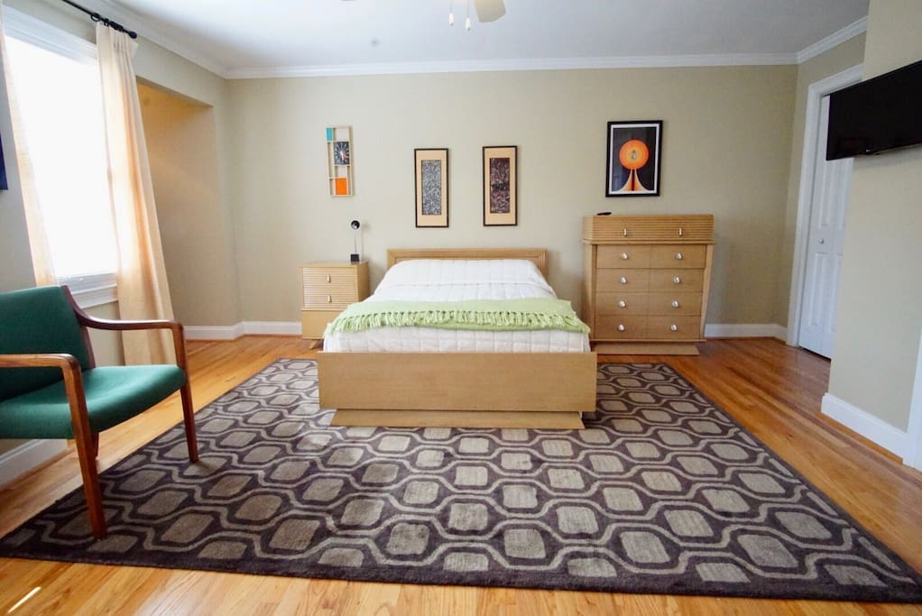 Full size bed in the master guest room with tons of space and natural light to energize your day!