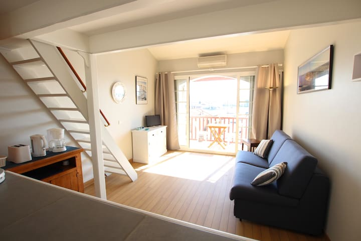 Renovated apartment with a large Mezzanine, A/C and a balcony.