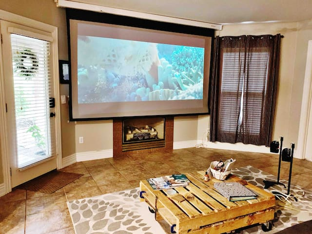 Smart Projection Home Theater with surround sound. Hulu, Prime Video, Vudu and more are available for your use (or you can use your own Netflix account) We do not have Cable. Full instructions on site for lowering the screen and using the system.