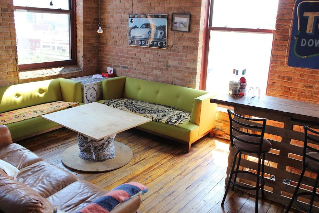 Three couch seating area with bar and great views of the city.
