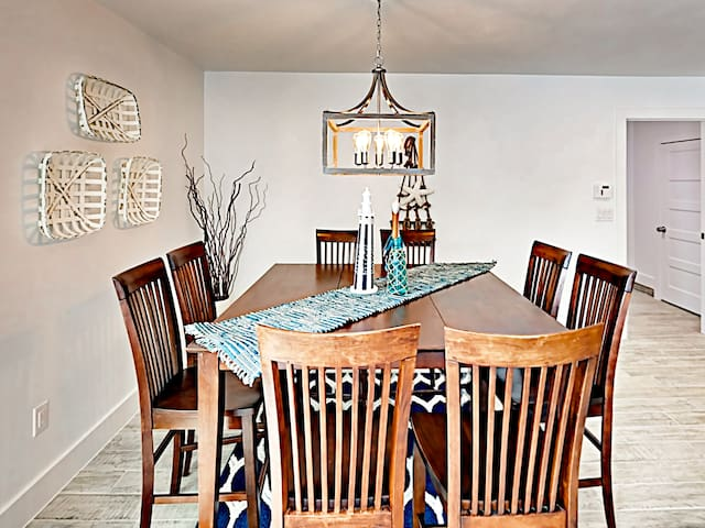 An elegant dining table offers seating for 8.