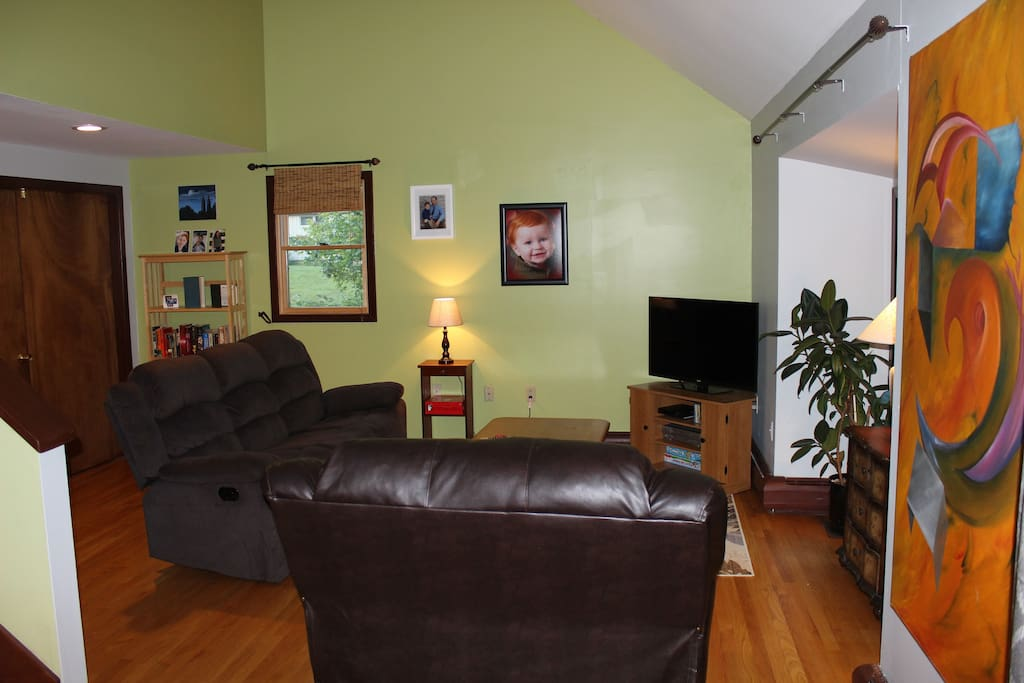 Living room space is open to guests. Bright and sunny room with vaulted ceilings. Walk out to screen house on deck.